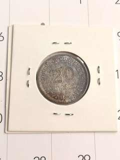 Toned coin1939 20 cents malaya silver