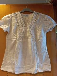 Woven top with crochet in cream color