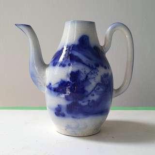 Beautiful blue and white porcelain tea pot .