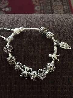 Silver bracelet with many charms. $29