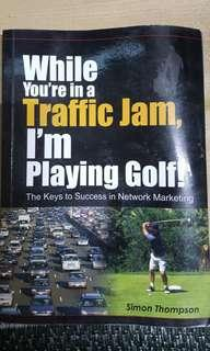While You're In A Traffic Jam, I'm Playing Golf by Simon Thompson