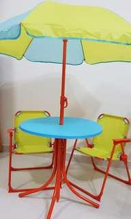 Colourful kids bench umbrella table and chairs