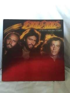Vinyl Record bee gees tin can