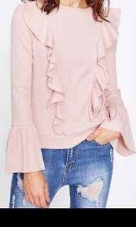 Pink ribbed knit top with trumpet sleeves