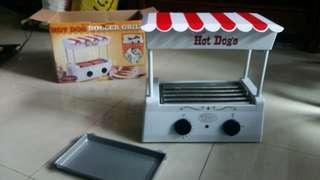 Old fashion hot dog roller grill
