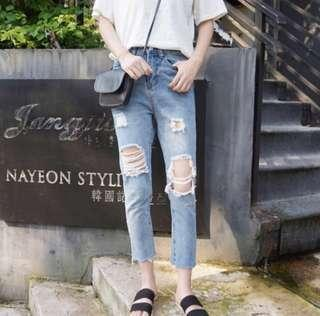 Light washed ripped denim boyfriend jeans