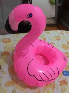 Cup holder flamingo on the pool