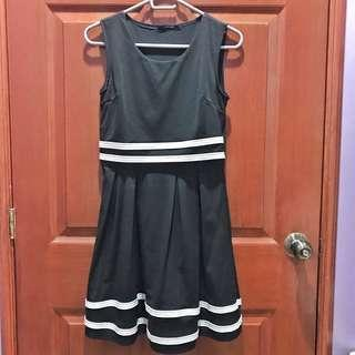 Black dress with white lining