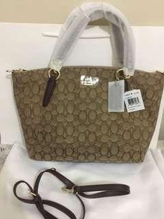 Coach kelsey canvas in signature authentic