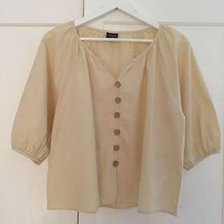 This is April Button Top