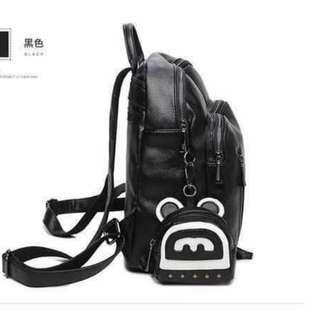 black backpack with coin purse