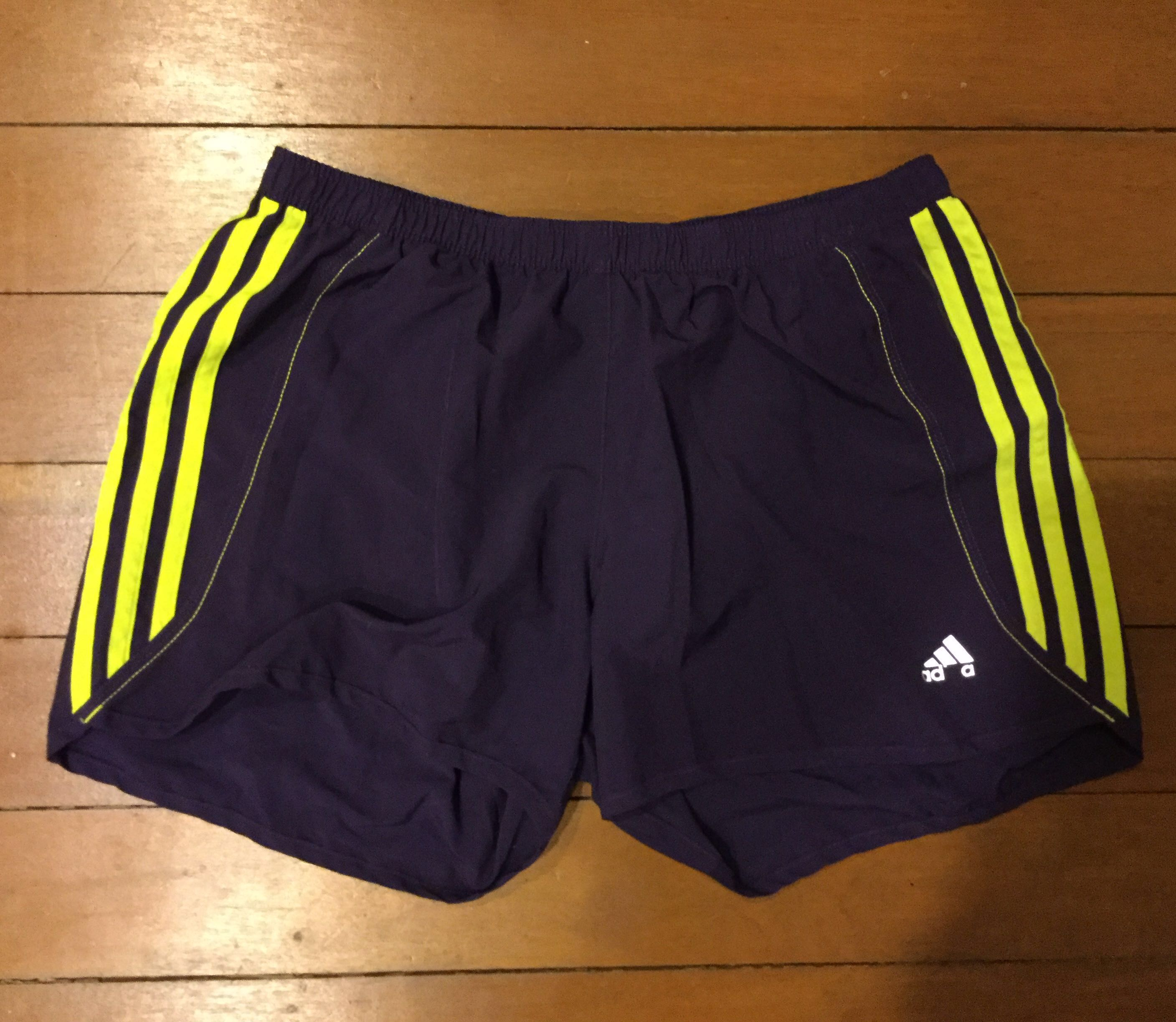 ead664ff7588 Adidas Climalite Dark Purple Shorts with Yellow Stripes