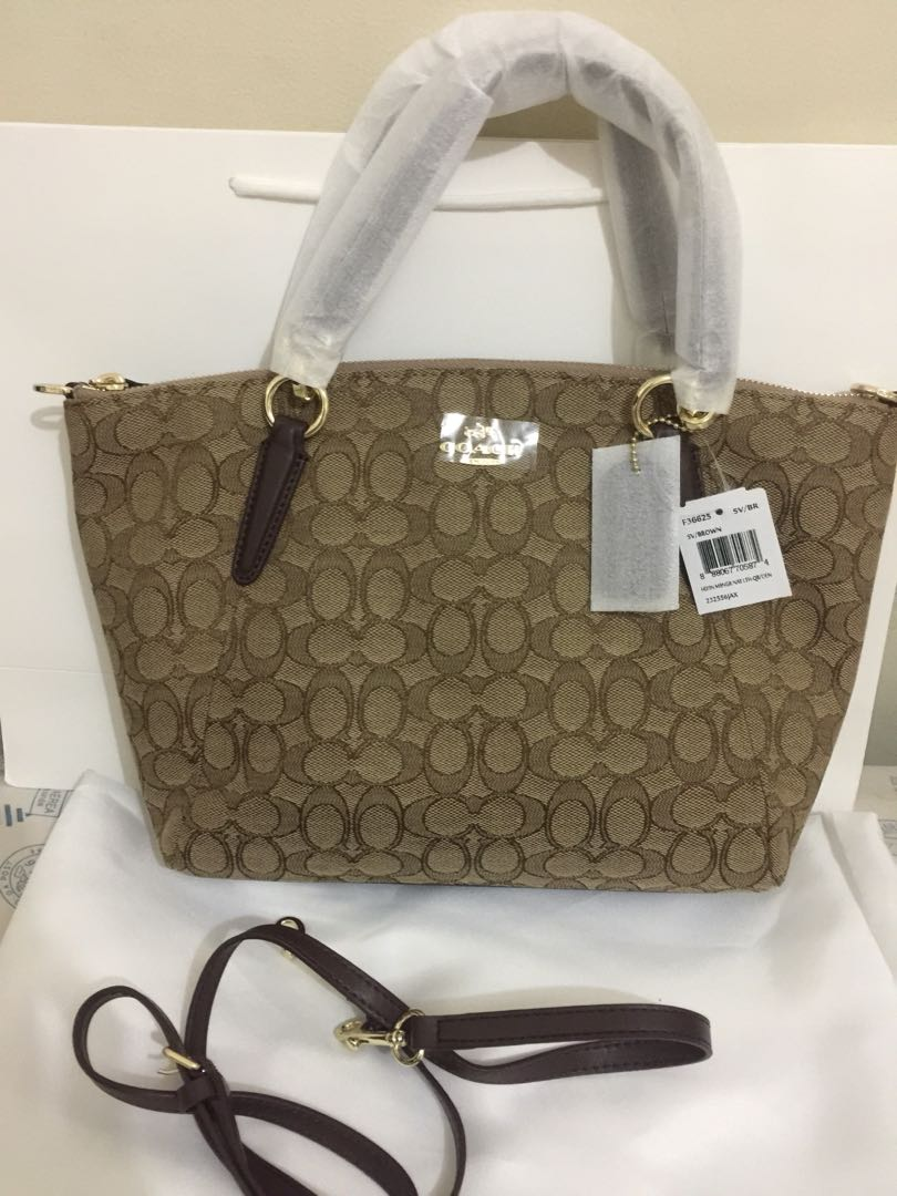 52ac19a008f3b Coach kelsey canvas in signature authentic