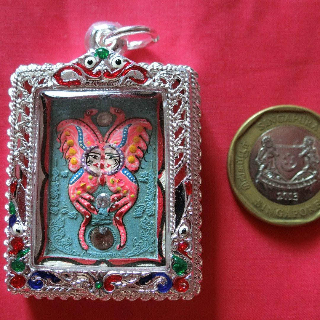 Kruba Krissana Holy Butterfly 2560 with 9 gems, 1 ruby, 4 takruts, 2 wealth spiders and silver longya casing