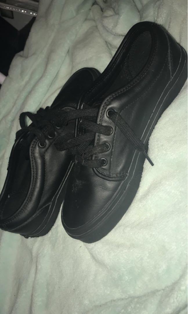 New black leather vans