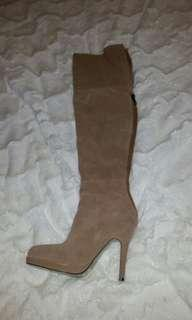 Tan coloured thigh high boots