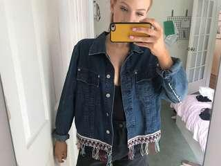 Deep blue denim jacket with bottom detailing
