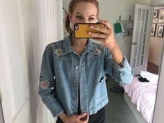 Light blue denim jacket with embroidery flower detailing