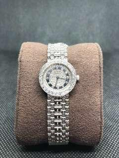 CHOPARD. A LADY'S 18K WHITE GOLD AND DIAMOND-SET BRACELET WATCH SIGNED CHOPARD, GENEVA, CASE NOS. 447 076AND 879 1