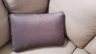 Brown pillow.  Enzol