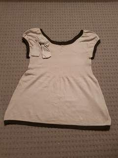 Light brown top with a bow