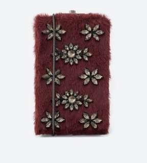 Burgundy furry embellished sling bag