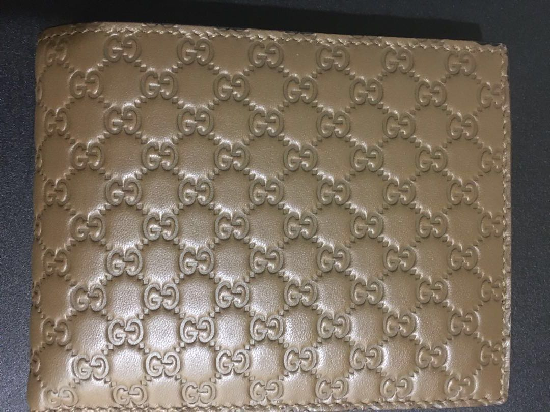 368a405c4aa Gucci leather micro gg guccissima trifold wallet