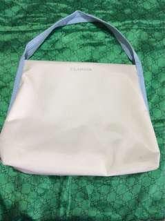 Clarins white pouch