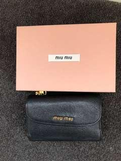 Miu Miu wallet in black pebble leather