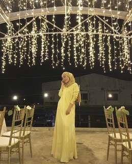 Pleated dress in pale yellow for rent