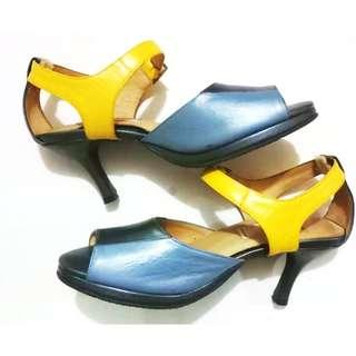 Gray and yellow ankle strap shoes