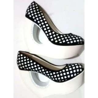 Black and white stylish platform shoes. Size 7