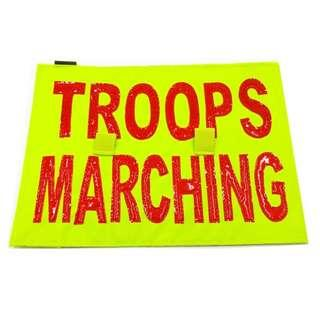 Troops Marching Sign, Reflective Nylon. With Two Strips of Rough Velcro at the back (Picture 2). Can stick to any soft Velcro. Measures 21.2 x 29.4cm.