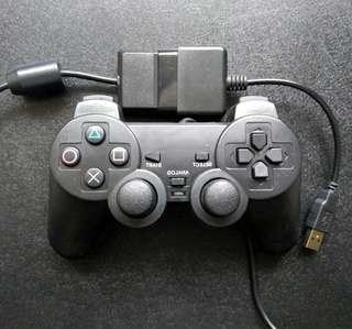 PS2 wired controller + PC adapter