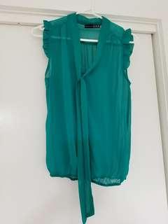 Atmosphere sleeveless top with bow size 10