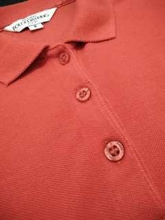 Folded and Hung Orange Polo Shirt