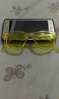 Folding yellow shades