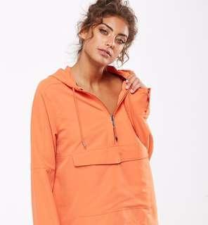 Orange half zip windbreaker