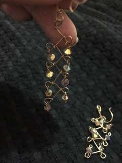 Swarovski dangling earings auth