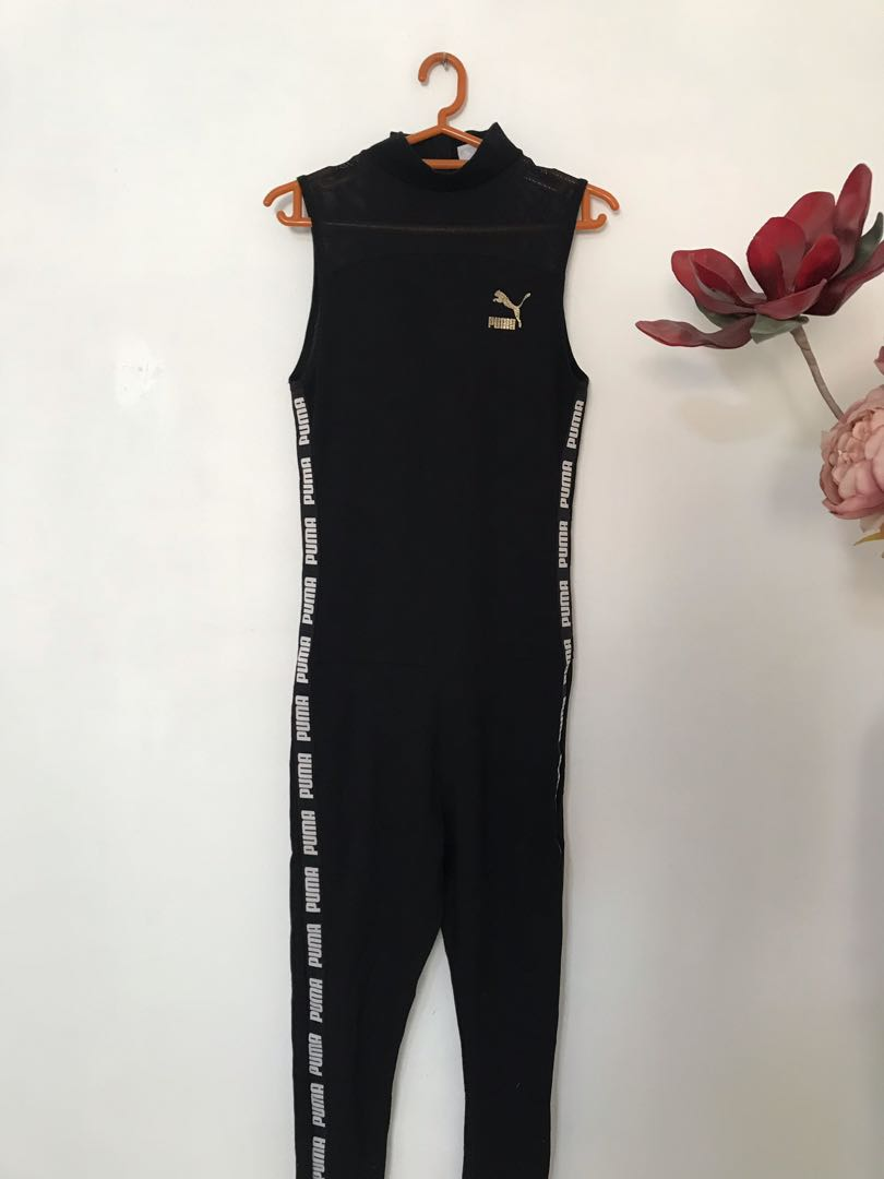 7f6b50929aed Puma exclusive to ASOS high neck jumpsuit in black