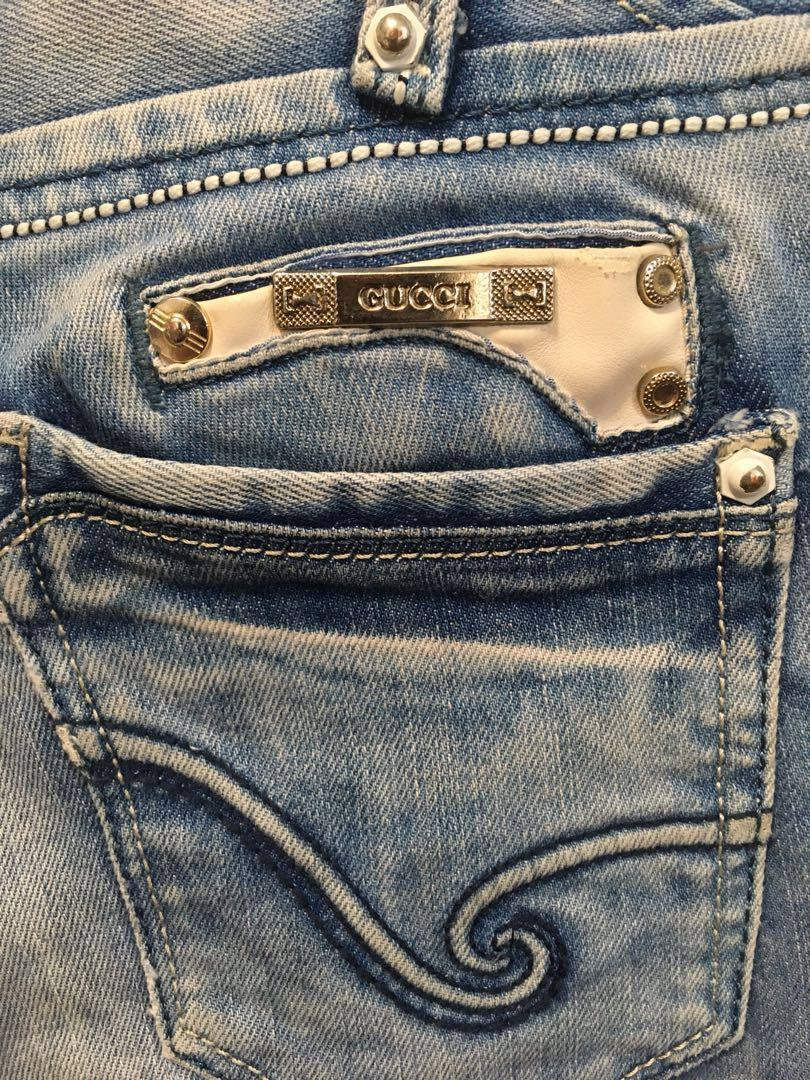 Vintage Authentic Gucci Ripped Jeans (size 27 low waist)