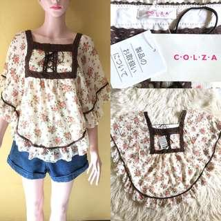 Atasan blouse motif