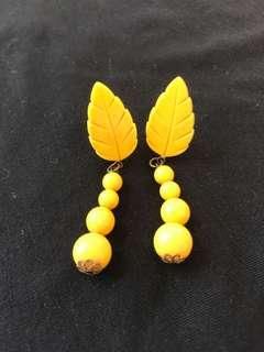 Vintage 70s yellow celluloid or plastic leaf and bead dangle faux earrings