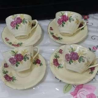Teacups wild roses red