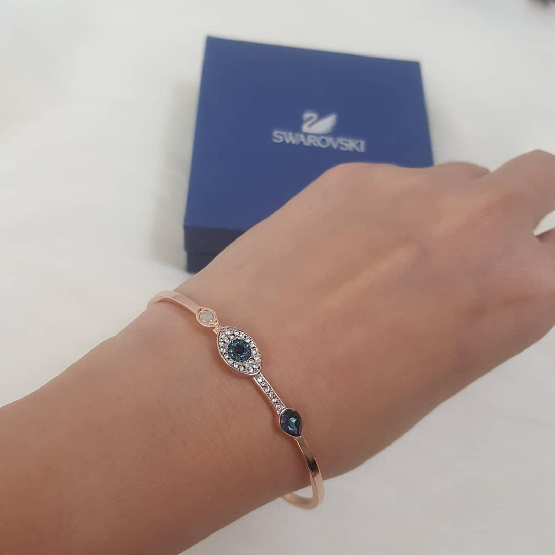 6cd46045e CLEARANCE SALE: Authentic Swarovski DUO EVIL EYE BANGLE, BLUE, MIXED  PLATING on Carousell