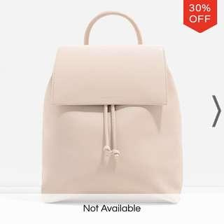 Charles & Keith pink front flap backpack