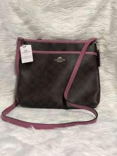 Coach file bag in brown and azalea lining
