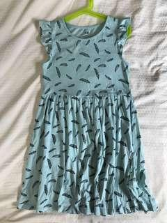Turquoise dress with feathers motif