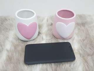 Ceramic oval cups with heart shape on the front