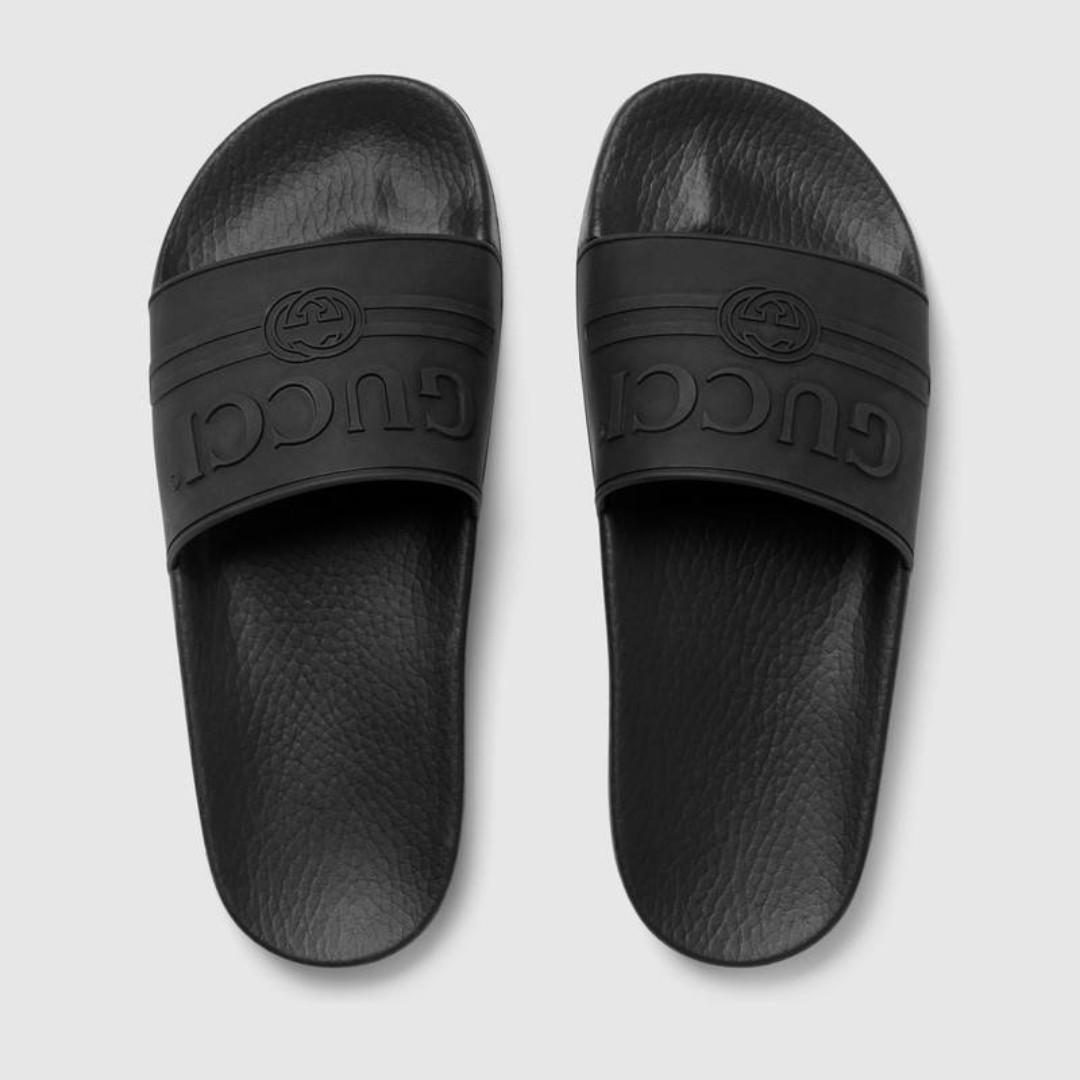 8272555ab Black Gucci logo rubber slide sandal